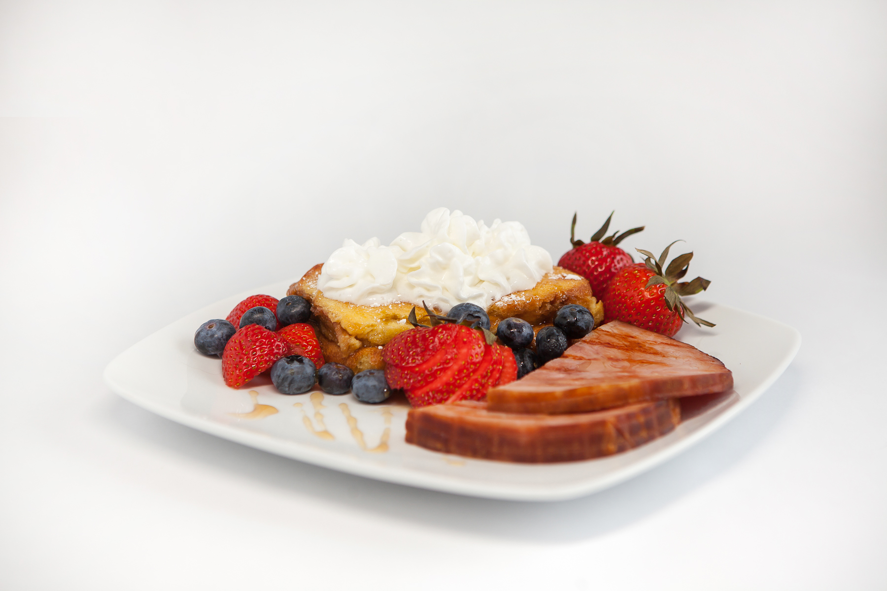 food photography and styling for Creme Brulee french toast, ham and fresh berries with whipped cream